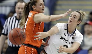 Notre Dame's Marina Mabrey (3) passes the ball as Syracuse's Tiana Mangakahia (4) defends during the first half of an NCAA college basketball game in the Atlantic Coast Conference women's tournament in Greensboro, N.C., Saturday, March 9, 2019. (AP Photo/Chuck Burton)