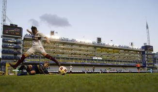 Boca Juniors' Yamila Rodriguez, below, fights for the ball with Lanus's Leila Garcia during the Superliga women's soccer tournament in Buenos Aires, Argentina, Saturday, March 9, 2019. The women competed in one of Argentina's most famous stadiums on Saturday, a milestone for the female players who are fighting for the same rights as male soccer players in the country's most popular sport. (AP Photo/Natacha Pisarenko)