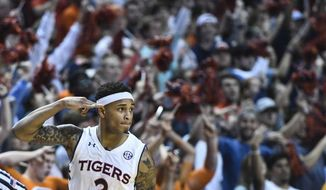Auburn guard Bryce Brown (2) celebrates a 3-point basket against Tennessee during the first half of an NCAA college basketball game Saturday, March 9, 2019, in Auburn, Ala. (AP Photo/Julie Bennett)