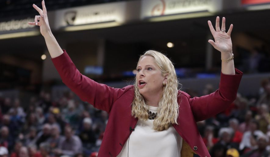 Maryland head coach Brenda Frese gestures in the first half of an NCAA college basketball semifinal game against Michigan at the Big Ten Conference tournament in Indianapolis, Saturday, March 9, 2019. (AP Photo/Michael Conroy)