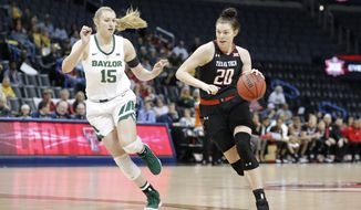 Texas Tech forward Brittany Brewer (20) drives to the basket as Baylor forward Lauren Cox (15) defends during the first half of an NCAA college basketball game in the Big 12 women's conference tournament in Oklahoma City, Saturday, March 9, 2019. (AP Photo/Alonzo Adams)