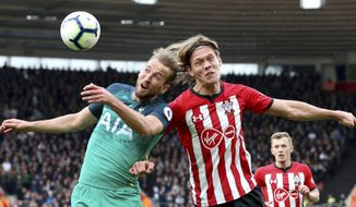 Tottenham Hotspur's Harry Kane, left, and Southampton's Jannik Vestergaard battle for the ball during the English Premier League soccer match at St Mary's Stadium, Southampton, England, Saturday March 9, 2019. (Andrew Matthews/PA via AP)