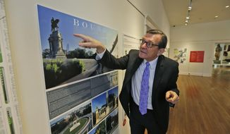 Director of the Valentine museum Bill Martin gestures as he looks over one of the proposals for changes to Confederate statues on Monument Avenue in Richmond, Va., Tuesday, Feb. 26, 2019. A new exhibit in Richmond showcases designs and ideas on what to do with Richmond's Confederate monuments. Local artists hope the exhibit will spark conversations about how to accurately document the city's history while not glorifying Confederate leaders. (AP Photo/Steve Helber)