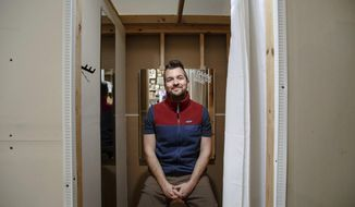 REPLACES ENTIRE CAPTION - In this Tuesday, Feb. 26, 2019 photo, Raygun owner and founder Mike Draper poses for a portrait in the store in Des Moines. After 14 years, 70 employees and four retail locations, he is ready to open the company's first store in Chicago in the summer. (Brian Powers/The Des Moines Register via AP)