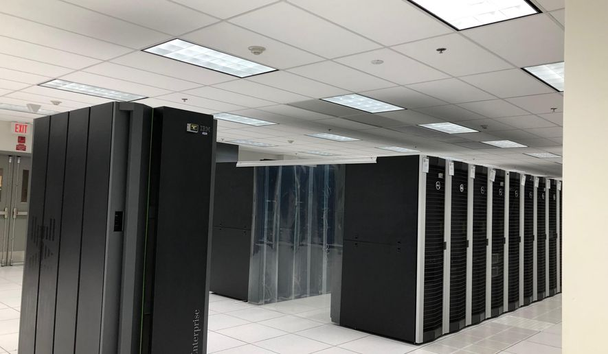 In this Dec. 20, 2018 photo computers at Chemical Abstracts Service store data that bound journals used to catalog chemical breakthroughs by scientists in Columbus, Ohio. Today computers in its 16,800-square-foot data center store three petabytes of information for CAS customers. (AP Photo/Julie Carr Smyth)