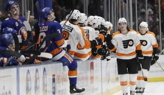 Philadelphia Flyers' Nolan Patrickcelebrates with teammates after scoring a goal during the second period of an NHL hockey game against the New York Islanders Saturday, March 9, 2019, in Uniondale, N.Y. (AP Photo/Frank Franklin II)