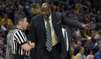 Georgetown head coach Patrick Ewing, right, argues with a referee after a foul against Marquette during the first half of an NCAA college basketball game Saturday, March 9, 2019, in Milwaukee. (AP Photo/Darren Hauck) ** FILE **