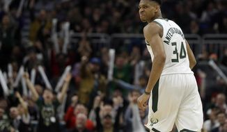 Milwaukee Bucks' Giannis Antetokounmpo reacts after making a shot during the second half of an NBA basketball game against the Charlotte Hornets Saturday, March 9, 2019, in Milwaukee. The Bucks won, 131-114. (AP Photo/Aaron Gash)