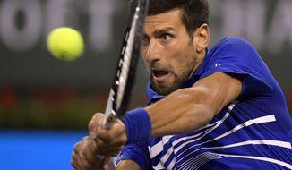 Novak Djokovic, of Serbia, returns to Bjorn Fratangelo at the BNP Paribas Open tennis tournament Saturday, March 9, 2019, in Indian Wells, Calif. (AP Photo/Mark J. Terrill)