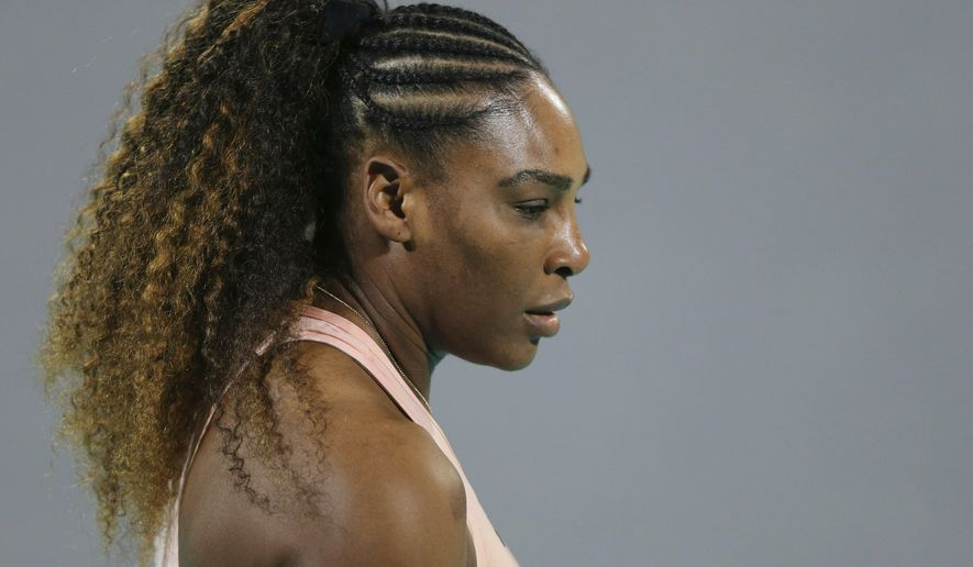 FILE - In this Dec. 27, 2018 file photo, Serena Williams from the U.S. reacts during a match against her sister Venus, on the opening day of the Mubadala World Tennis Championship in Abu Dhabi, United Arab Emirates. Williams beat Victoria Azarenka 7-5, 6-3 in the second round of the BNP Paribas Open on Friday, March 8, 2019.  Both players returned from maternity leave a year ago at the desert tournament.    (AP Photo/Kamran Jebreili, File)