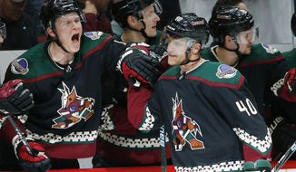 Arizona Coyotes right wing Michael Grabner (40) celebrates his goal against the Los Angeles Kings with Coyotes' Jakob Chychrun, left, during the first period of an NHL hockey game Saturday, March 9, 2019, in Glendale, Ariz. (AP Photo/Ross D. Franklin)