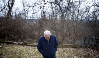 In this Tuesday, Feb. 19, 2019 photo, Tom Gerrein stands in his backyard in Bellevue, Ky. He and his wife moved into their home in the summer of 1969. On Easter morning in 2010, they came home from church to find a landslide they have since learned is affecting more than 35 properties in Bellevue. (Meg Vogel/The Cincinnati Enquirer via AP)