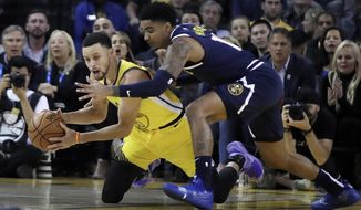 Golden State Warriors' Stephen Curry, left, looks to pass the ball away from Denver Nuggets' Gary Harris during the first half of an NBA basketball game Friday, March 8, 2019, in Oakland, Calif. (AP Photo/Ben Margot)