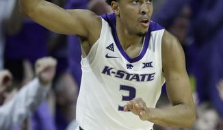 Kansas State guard Kamau Stokes (3) celebrates a three-point basket during the first half of an NCAA college basketball game against Oklahoma in Manhattan, Kan., Saturday, March 9, 2019. (AP Photo/Orlin Wagner)