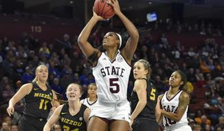 Mississippi State's Anriel Howard, center, shoots while defended by Missouri's Haley Troup (11) Jordan Chavis (24) and Lauren Aldridge during the first half of an NCAA college basketball game in the Southeastern Conference women's tournament Saturday, March 9, 2019, in Greenville, S.C. (AP Photo/Richard Shiro)