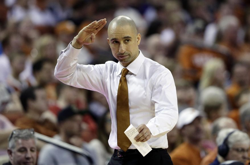 Texas head coach Shaka Smart signals to his players during the second half of an NCAA college basketball game against TCU, Saturday, March 9, 2019, in Austin, Texas. (AP Photo/Eric Gay)