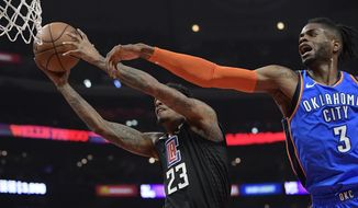 Los Angeles Clippers guard Lou Williams, left, shoots as Oklahoma City Thunder forward Nerlens Noel defends during the first half of an NBA basketball game Friday, March 8, 2019, in Los Angeles. (AP Photo/Mark J. Terrill)