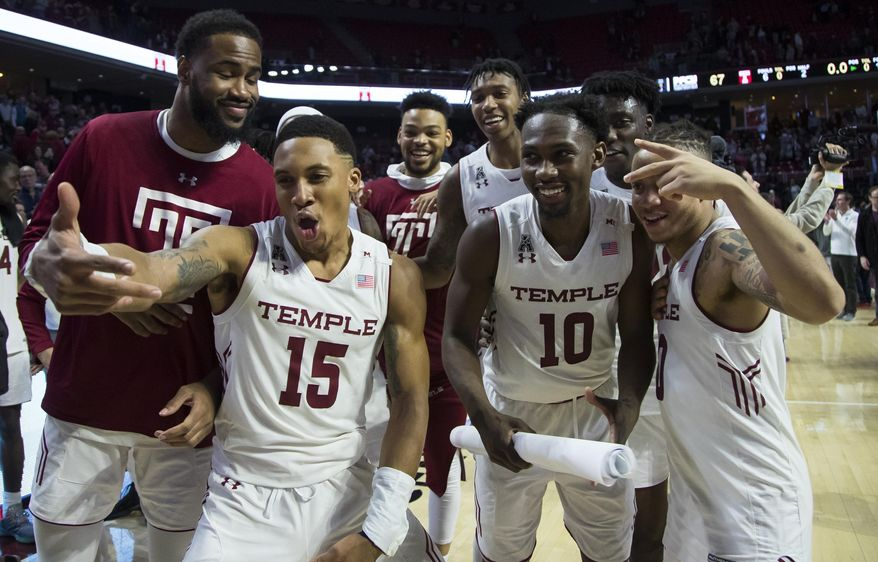 Temple celebrates the win after the second half of an NCAA college basketball game against Central Florida, Saturday, March 9, 2019, in Philadelphia. Temple won 67-62. (AP Photo/Chris Szagola)