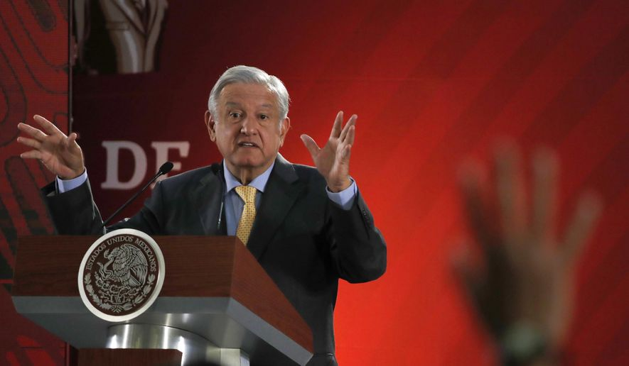 In this Friday, March 8, 2019, photo, Mexican President Andres Manuel Lopez Obrador answers questions from journalists at his daily 7 a.m. press conference at the National Palace in Mexico City. Lopez Obrador's first 100 days in office have combined a compulsive shedding of presidential trappings with a dizzying array of policy initiatives, and a series of missteps haven't even dented his soaring approval ratings. (AP Photo/Marco Ugarte)