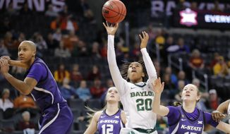 Baylor guard Juicy Landrum (20) shoots between Kansas State guard Rachel Ranke (12) and Kansas State forward Laura Macke (13) during the first half of an NCAA college basketball game in the Big 12 women's conference tournament in Oklahoma City, Sunday, March 10, 2019. (AP Photo/Alonzo Adams)