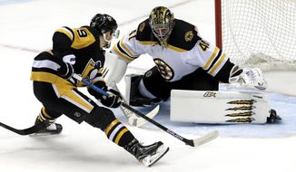 Pittsburgh Penguins' Jared McCann (19) prepares to put a shot around Boston Bruins goaltender Jaroslav Halak (41) for a short-handed goal during the first period of an NHL hockey game in Pittsburgh, Sunday, March 10, 2019. (AP Photo/Gene J. Puskar)