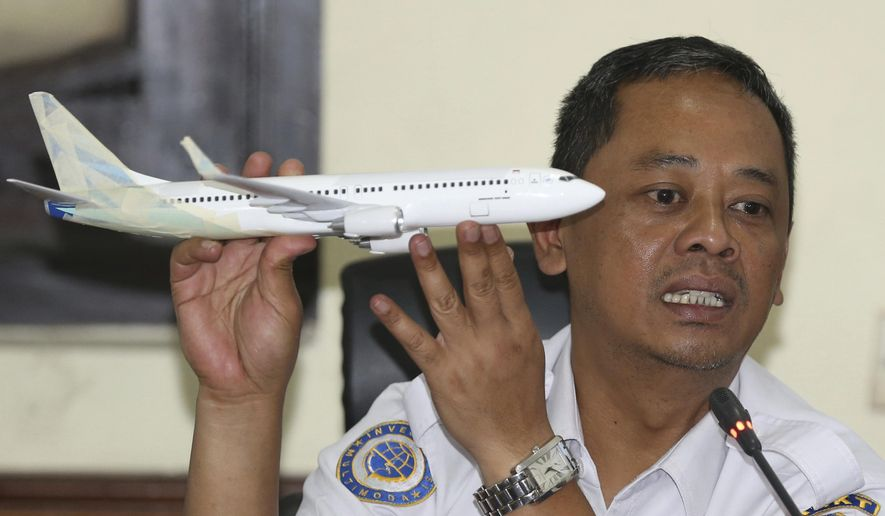 In this Nov. 28, 2018, file photo, National Transportation Safety Committee investigator Nurcahyo Utomo holds a model of an airplane during a press conference on the committee's preliminary findings on their investigation on the crash of Lion Air flight 610, in Jakarta, Indonesia. China's civilian aviation authority has ordered all Chinese airlines to temporarily ground their Boeing 737 Max 8 planes after one of the aircraft crashed in Ethiopia. The Civil Aviation Administration of China said the order was issued at 9 a.m. Beijing time Monday, March 11, 2019, and would last nine hours. (AP Photo/Achmad Ibrahim, File)