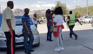 Family members arrive at Bole International airport in Addis Ababa, Ethiopia, Sunday, March 10, 2019, to check on information on the Ethiopian flight that crashed. An Ethiopian Airlines flight crashed shortly after takeoff from Ethiopia's capital on Sunday morning, killing all 157 people thought to be on board, the airline and state broadcaster said. (AP Photo/Elias Masseret)