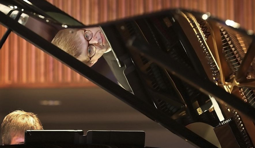 "Music historian and pianist Garik Pedersen performs ""Moonlight Serenade"" by Glen Miller during his program called ""The Steinway Victory Vertical Project"" at Second Baptist Church on March 2, 2019. Pedersen talked about and performed music that was meant to improve morale among the American troops during WWII.  (Jim Weber/Daily Memphian via AP)"