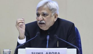 India's Chief Election Commissioner Sunil Arora speaks during a press conference in New Delhi, India, Sunday, March 10, 2019. India's Election Commission has announced that the upcoming national election will be held in seven phases in April and May as Prime Minister Narendra Modi's Hindu nationalist party seeks a second term. (AP Photo/ Manish Swarup)