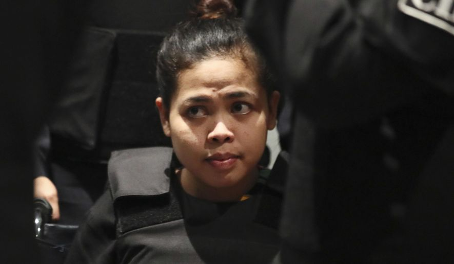 FILE - In this Oct. 24, 2017, file photo, Indonesian Siti Aisyah waits at Kuala Lumpur International Airport in Sepang, Malaysia. The Indonesian woman held two years on suspicion of killing the North Korean leader's half brother was freed from custody Monday, March 11, 2019 after prosecutors unexpectedly dropped the murder charge against her. (AP Photo/Sadiq Asyraf, File)