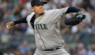 FILE - In this Wednesday, June 20, 2018 file photo, Seattle Mariners starting pitcher Felix Hernandez throws during the first inning of a baseball game against the New York Yankees at Yankee Stadium in New York. Felix Hernandez says he's upset to have been passed over for opening day, but the longtime Seattle Mariners ace isn't surprised. Hernandez spoke publicly Sunday, march 10, 2019 for the first time since manager Scott Servais announced a day earlier that Marco Gonzales would pitch Seattle's season opener against Oakland in Japan on March 20. (AP Photo/Seth Wenig, File)