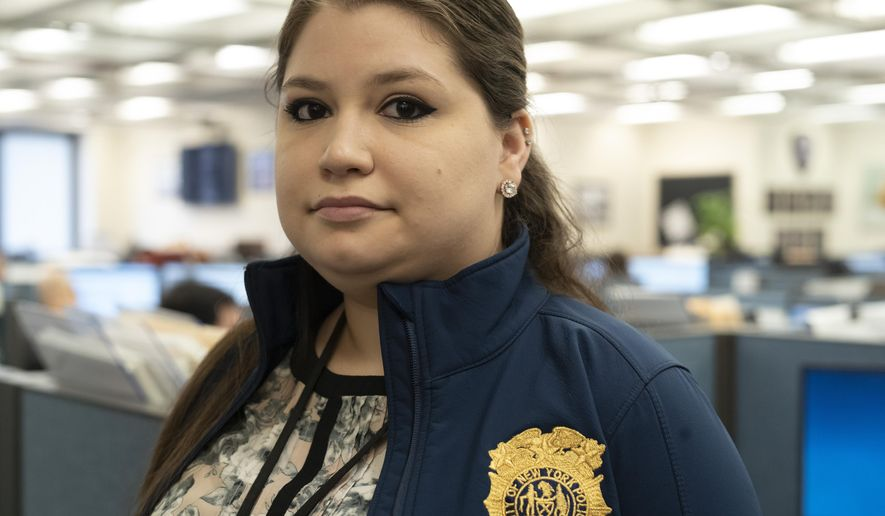 In this Feb. 11, 2019 photo, Rebecca Shutt, who works in the New York Police Department's Office of Crime Control Strategies, poses for a photo in New York. Shutt utilizes a software called Patternizr, which allows crime analysts to compare robbery, larceny and theft incidents to the millions of crimes logged in the NYPD's database, aiding their hunt for crime patterns. It's much faster than the old method, which involved analysts sifting through reports and racking their brains for similar incidents. (AP Photo/Mark Lennihan)