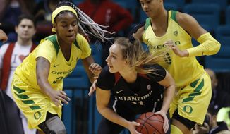 Oregon's Ruthy Hebard, left, and Satou Sabally, right, guard Stanford's Alanna Smith during the first half of an NCAA college basketball game in the final of the Pac-12 women's tournament Sunday, March 10, 2019, in Las Vegas. (AP Photo/John Locher)