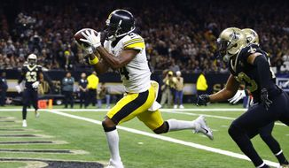 FILE - In this Dec. 23, 2018, file photo, Pittsburgh Steelers wide receiver Antonio Brown (84) pulls in a pass reception in front of New Orleans Saints cornerback Marshon Lattimore, foreground right, and strong safety Kurt Coleman in the second half of an NFL football game in New Orleans. A person with direct knowledge of the situation told The Associated Press on Saturday, March 9, 2019, that the Oakland Raiders have an agreement to acquire receiver Brown in a trade with the Steelers and will give him a new contract. (AP Photo/Butch Dill) ** FILE **