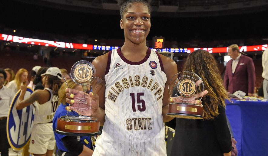 Mississippi State's Teaira McCowan holds her MVP and All-Tournament team trophies after winning an NCAA college basketball championship game against Arkansas in the Southeastern Conference women's tournament, Sunday, March 10, 2019, in Greenville, S.C. (AP Photo/Richard Shiro)