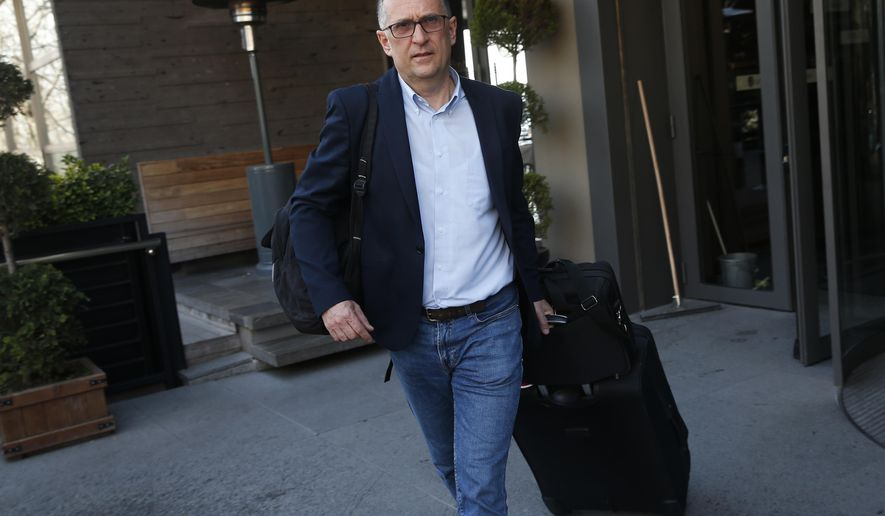 German broadcaster ZDF's Istanbul bureau chief Joerg Brase walks to a car on his way to the airport to leave the country, in Istanbul, Sunday, March 10, 2019. Brase and Thomas Seibert of Tagesspiegel were stripped of their press credentials to work in Turkey and had left the country. They have called the government's move an attempt to silence international media and German officials have criticised Turkey's refusal to renew their accreditations. (AP Photo/Lefteris Pitarakis)