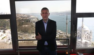 German broadcaster ZDF's Istanbul bureau chief Joerg Brase poses for photographs in Istanbul, Sunday, March 10, 2019. Brase and Thomas Seibert of Tagesspiegel were stripped of their press credentials to work in Turkey and had left the country. They have called the government's move an attempt to silence international media and German officials have criticised Turkey's refusal to renew their accreditations. (AP Photo/Lefteris Pitarakis)