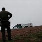 """Hundreds of man hours are wasted each day at a time of crisis on the border,"" said the leaders of the National ICE Council in a letter. Border Patrol agent Vincent Pirro looks on near where a border wall ends that separates the cities of Tijuana, Mexico, and San Diego, Tuesday, Feb. 5, 2019, in San Diego. President Donald Trump is expected to speak about funding for a wall along the U.S.-Mexico border during his State of the Union address Tuesday. (AP Photo/Gregory Bull) (Associated Press)"
