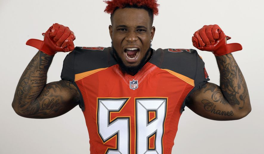 FILE - This is a June 6, 2018, file photo showing Tampa Bay Buccaneers outside linebacker Kwon Alexander during a studio photo session at the team training facility, in Tampa, Fla. The San Francisco 49ers have agreed to sign linebacker Kwon Alexander to a four-year contract worth $54 million. A person familiar with the contract said the sides came to an agreement Monday, March 11, 2019, soon after teams were allowed to contact pending unrestricted free agents. The person spoke on condition of anonymity because the deal can't be finalized until the new league year starts Wednesday. (AP Photo/Chris O'Meara, File)