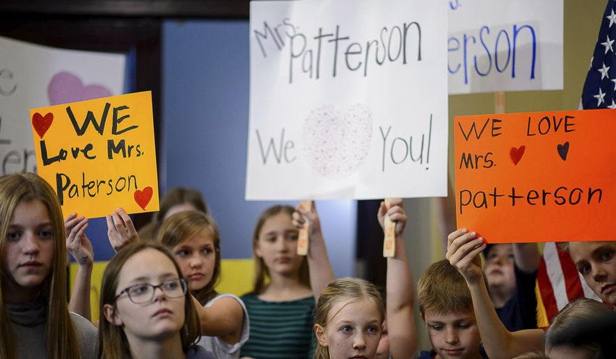 Valley View Elementary School students show support for teacher Moana Patterson at a news conference in Salt Lake City, Monday, March 11, 2019. Patterson, who is on administrative leave, apologized Monday for making 9-year-old Catholic student William McLeod wash off the Ash Wednesday cross from his forehead the week before, saying it was a misunderstanding. (Trent Nelson/The Salt Lake Tribune via AP)