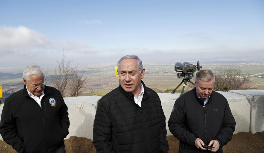 Israeli Prime Minister Benjamin Netanyahu, center, Republican U.S. Senator Lindsey Graham, right, and U.S. Ambassador to Israel David Friedman visit the border between Israel and Syria at the Israeli-held Golan Heights, Monday, March 11, 2019. Graham says he will push for American recognition of Israeli sovereignty over the Golan Heights, a territory it captured from Syria in the 1967 Mideast war. (Ronen Zvulun/Pool via AP)