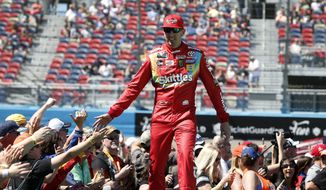 Kyle Busch is greeted by fans during driver introductions prior to the start of the NASCAR Cup Series auto race at ISM Raceway, Sunday, March 10, 2019, in Avondale, Ariz. (AP Photo/Ralph Freso) **FILE**