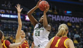 Baylor center Kalani Brown (21) goes to the basket as Iowa State forward Meredith Burkhall (32) defends during the first half of an NCAA college basketball game in the Big 12 women's conference tournament championship in Oklahoma City, Monday, March 11, 2019. (AP Photo/Alonzo Adams)