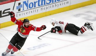 Chicago Blackhawks left wing Brendan Perlini (11) celebrates after scoring against the Arizona Coyotes during the third period of an NHL hockey game Monday, March 11, 2019, in Chicago. (AP Photo/Kamil Krzaczynski)