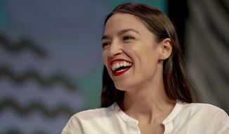 Rep. Alexandria Ocasio-Cortez, D-New York, laughs during South by Southwest on Saturday, March 9, 2019, in Austin, Texas. The festival has grown from obscure roots into a weeklong juggernaut of tech, politics and entertainment. (Nick Wagner/Austin American-Statesman via AP) ** FILE **