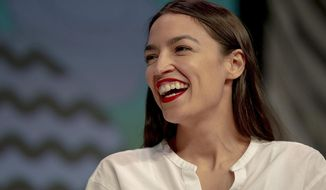Rep. Alexandria Ocasio-Cortez, D-New York, laughs during South by Southwest on Saturday, March 9, 2019, in Austin, Texas. The festival has grown from obscure roots into a weeklong juggernaut of tech, politics and entertainment. (Nick Wagner/Austin American-Statesman via AP)