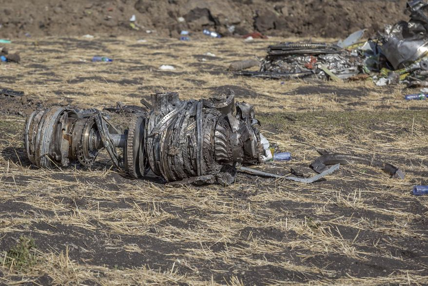 Airplane parts lie on the ground at the scene of an Ethiopian Airlines flight crash near Bishoftu, or Debre Zeit, south of Addis Ababa,  Ethiopia, Monday, March 11, 2019. A spokesman says Ethiopian Airlines has grounded all its Boeing 737 Max 8 aircraft as a safety precaution, following the crash of one of its planes in which 157 people were killed. (AP Photo/Mulugeta Ayene)