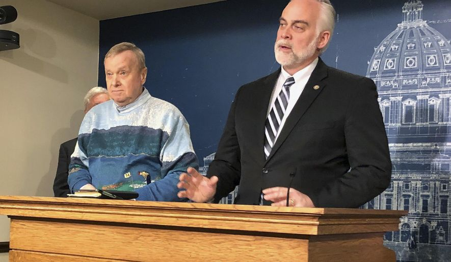 Minnesota State Reps. Gene Pelowski, D-Winona, left, and Tony Albright, R-Prior Lake, discuss legislation to replenish a disaster aid fund ahead of anticipated spring flooding during a news conference at the state Capitol in St. Paul, Minn., Monday, March 11, 2019. Lawmakers are pushing to replenish a nearly empty disaster fund ahead of anticipated spring flooding. Republican lawmakers at a news conference highlighted a proposal for $40 million to refill the depleted fund. But House Democrat Pelowski, says it's meant for disasters between legislative sessions. If there is serious flooding this spring, Pelowski says, the Legislature would approve aid while it's still in session. (AP Photo/Steve Karnowski)