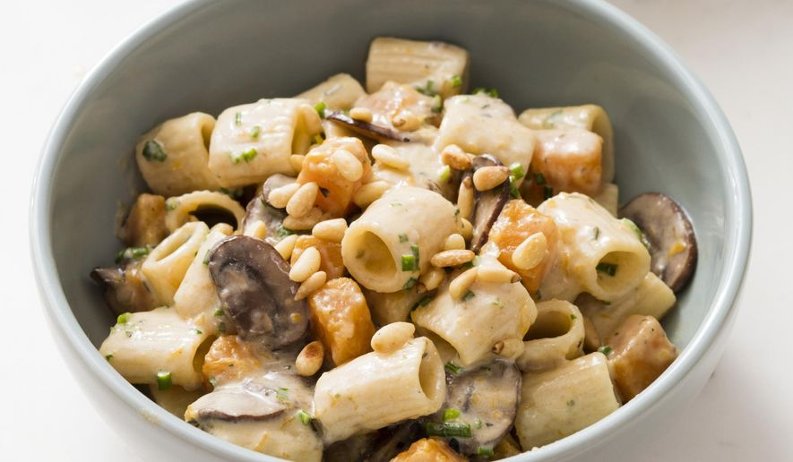 """This undated photo provided by America's Test Kitchen in March 2019 shows Creamy Rigatoni With Mushrooms. The recipe appears in the cookbook """"Cook it in Your Dutch Oven."""" (Daniel J. van Ackere/America's Test Kitchen via AP)"""
