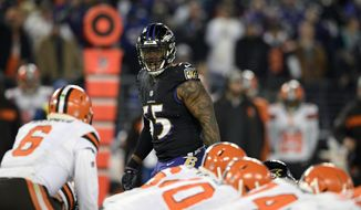FILE - In this Sunday, Dec. 30, 2018 file photo,Baltimore Ravens outside linebacker Terrell Suggs (55) looks across the line of scrimmage in the second half of an NFL football game against the Cleveland Browns in Baltimore. Defense is the area with the most depth in this year's free agency class, Monday, March 11, 2019. (AP Photo/Nick Wass, File) **FILE**